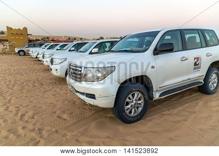 DUBAI UNITED ARAB EMIRATES - JANUARY 25 2016: Desert Safari Dubai rally off-road Toyota car 4x4 adventure driving in the desert sand dune is a popular activity among tourists in Dubai.