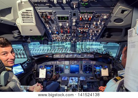 DUBAI UAE - JANUARY 26: Captain pilot and co-pilot in the Flight Deck cockpit of Boeing 747. Airline pilots at work on January 10 2016 in Dubai Airport