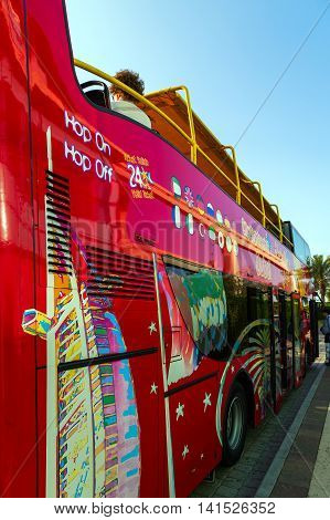 DUBAI UAE - JANUARY 26: Big Bus excursion Dubai The Day Tour is a hop-on hop-off City Sightseeing Dubai with a personal recorded commentary available in 12 languages. Dubai UAE circa January 2016