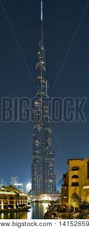 DUBAI UAE - JANUARY 23 2016: Vertical night panorama architecture of Burj Khalifa tallest building in the world 829.8 m. Dubai Burj Khalifa United Arab Emirates