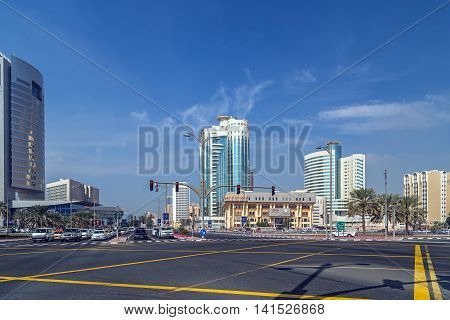 DUBAI UAE - JANUARY 23: People on the street architecture of Dubai's many highrise buildings. Dubai with many traditional arabic shops and biggest street market. Dubai UAE circa January 2016