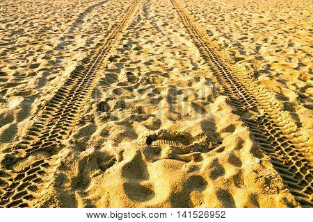 Shoes Footprint And Trace Tyre Sand