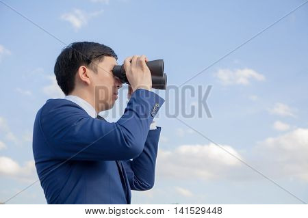 Asian Businessman Searching And Looking For Future Opportunities