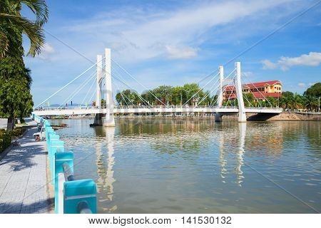 PHANTHIET, VIETNAM - DECEMBER 24, 2015: View on the modern cable-stayed bridge over the river Tu Sa in Phan Thiet. Tourist landmark of the Vietnam