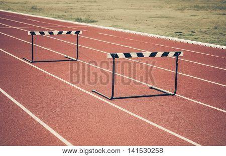 Jump hurdle on running track in stadium
