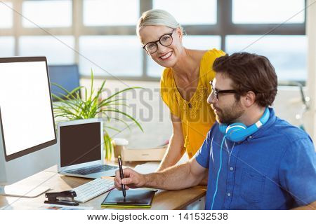 Graphic designers using graphic tablet in office