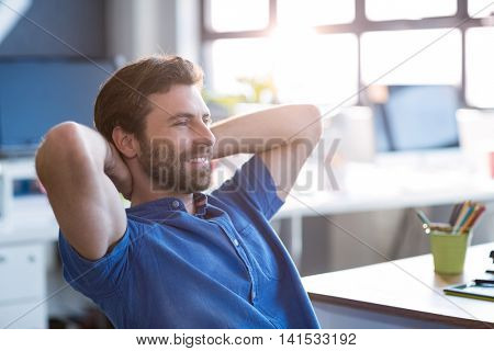 Thoughtful graphic designer sitting in office