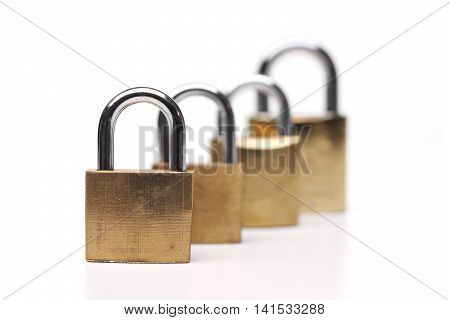 four security locks queuing from small to big size on isolated background