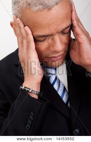 Stressed Businessman Man With Headache