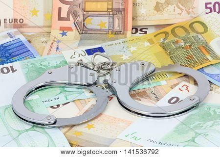 Silver handcuffs and lot of money around