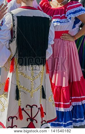 Detail of Serbian and Costa Rican folk costume for women with multicolored embroidery.