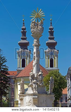 Holy Trinity Statue and Serbian church located on Union Square in Timisoara Romania.