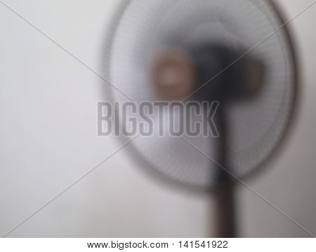 motion blurred image of brown electric fan