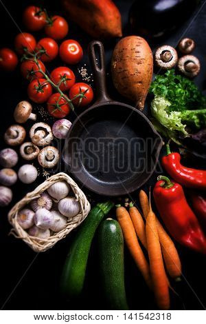 Frame of vegetables with old skillet healthy or vegetarian concept top view copy space
