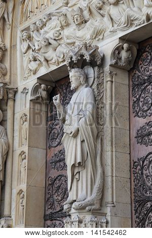 PARIS, FRANCE - MAY 13, 2015: This is statue of Jesus at the entrance to the Notre Dame de Paris