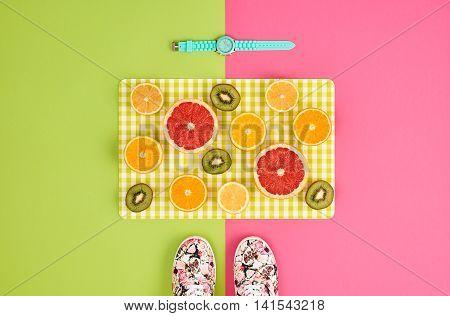 Fashion. Summer Accessories fashion set. Tropical Fruit Citrus Orange Grapefruit Lime Kiwi. Fashion woman Glamor Wrist Watches Trendy Gumshoes. Stylish girl. Fashion creative concept. Minimal Art