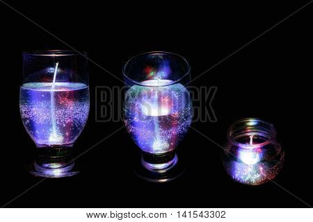 close up shot of transparent gel candle in glass.
