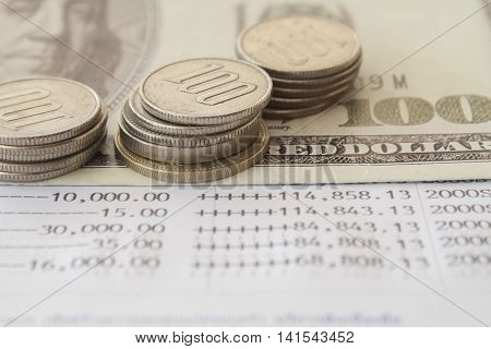 notebook bank passbook report money deposit and coins