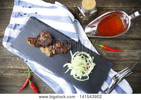 BBQ steak. Barbecue grilled beef steak meat with red barbecue sauce. Healthy food. Barbeque steak dinner