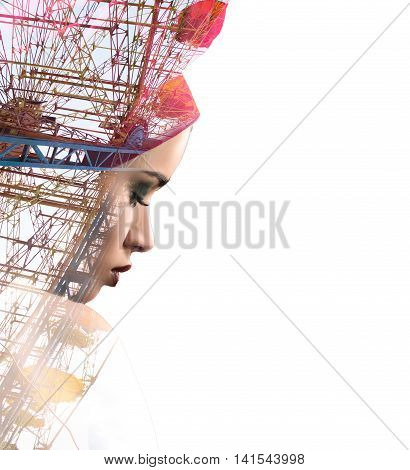 Sad woman combined with big panoramic wheel on white. Double exposure shot of beautiful latin female with red scarf on head.