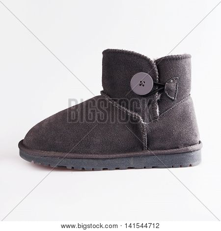 female grey ugg boots over white background