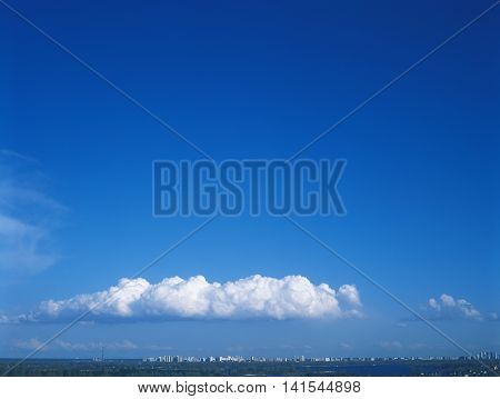 White clouds on the blue sky. Useful as background in your projects.