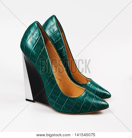 summer female green shoes over white background