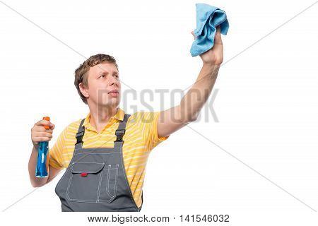 Man In A Overalls Holds A Bottle With Spray And Rag On A White Background