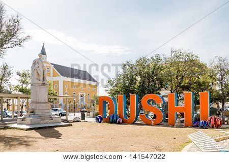 Orange Dushi sign in Curacao park at Christmas
