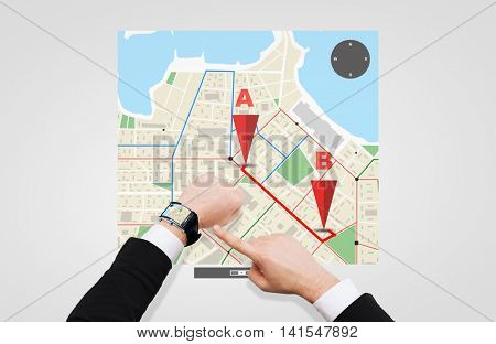 business, people and modern technology concept - close up of businessman pointing to smart watch at his hand with gps navigator map on screen