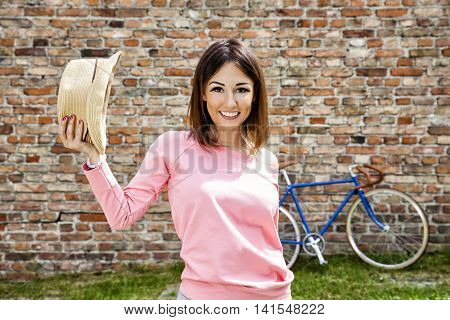 Attractive Woman With A Hat In The Park