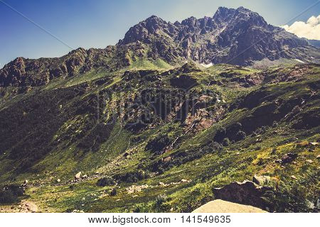 High Rocky Mountains and blue sky Landscape in Abkhazia Summer Travel serene scenic view