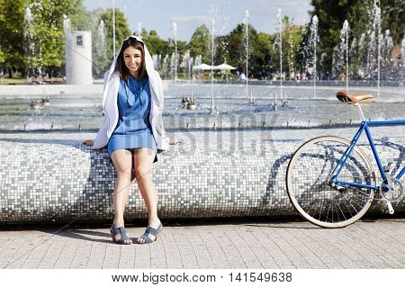 Girl Sitting On The Fountain