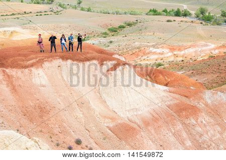 group of people taking pictures of Red Mountain