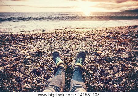 Woman Feet sneakers on beach sea sunset Travel Lifestyle Summer vacations trendy concept