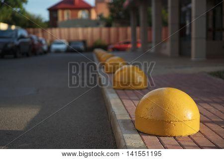 Concrete hemisphere prohibiting parking barrier. zone parking.