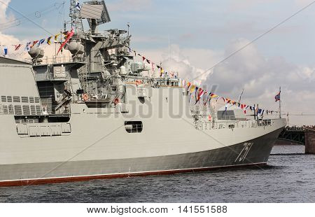 St. Petersburg, Russia - 31 July, Warship with festive flags signaling, 31 July, 2016. Festive parade of warships on the Neva River in St. Petersburg.
