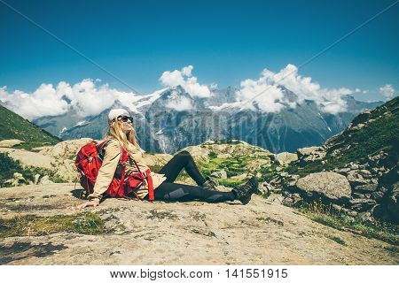 Woman Traveler with backpack relaxing with mountains and clouds landscape on background Travel Lifestyle concept adventure summer vacations