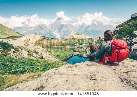 Traveler Man with backpack relaxing enjoying Travel Lifestyle concept mountains landscape on background summer vacations outdoor