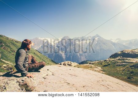 Man Traveler relaxing in mountains Travel Lifestyle concept scenic landscape on background summer vacations outdoor