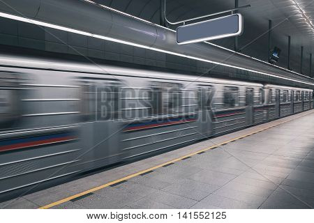 Subway train fast moving in underground tube, motion blur from the track empty space. Concept for motion, timeless, fast motion, passing by, observing, still life, perspective.