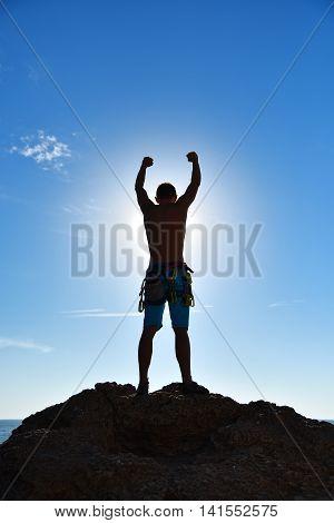 Extreme Climber Raising Hands