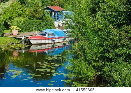 Boatshouse on the river Warnow in Rostock (Germany).