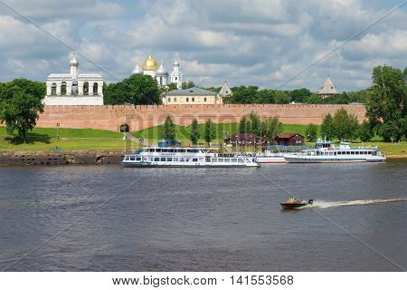 VELIKIY NOVGOROD, RUSSIA - JULY 02, 2016: Tourist ships are at the pier, the cloudy july day on the river Volkhov. Tourist landmark of the city Veliky Novgorod