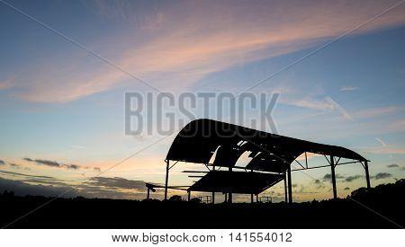 Derelict Barn Silhouette Against Beautiful Vibrant Sunset Landscape