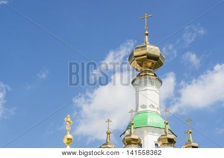 An beautiful view of the Tolga Convent of the Presentation of the Blessed Virgin with golden domes and part of walls near Yaroslavl, Russia.