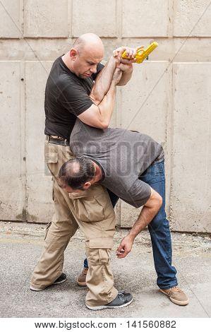 Gun Disarm. Self Defense Techniques Against A Gun Point.