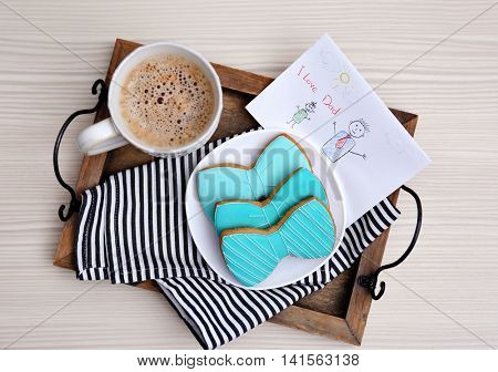 Tasty cookies with coffee on table. Happy fathers day concept