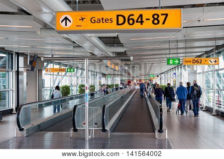 SCHIPHOL THE NETHERLANDS - MAY 16 Travellers walking to the gate on May 16 2016 at Schiphol Airport The Netherlands