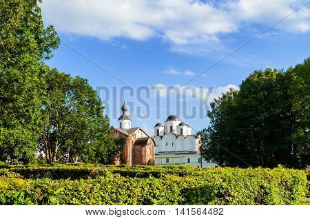Paraskeva Pyatnitsa church and St Nicholas cathedral at Yaroslav Courtyard in Veliky Novgorod Russia. Architecture landscape in sunny summer weather